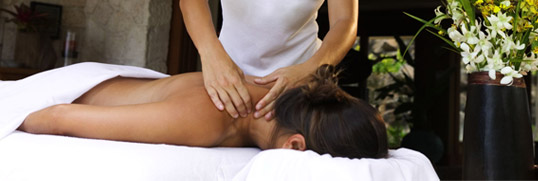 Massage therapist treating a client.